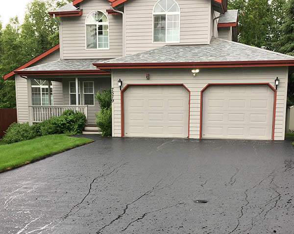 Oil based sealcoating of driveways in Anchorage by Nothing But Driveways